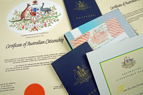 various australian citizenship documents and two passports